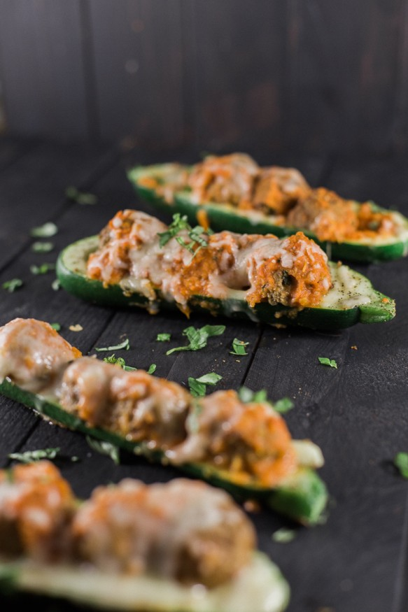 Zucchini boats topped with a quick and simple marinara made from fresh tomatoes, mozzarella, and Personal Trainer Food Meatballs