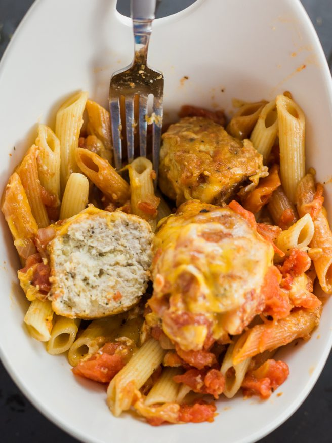 Turkey Meatball recipe with basil, oregano, and breadcrumbs, added into baked ziti. Perfect for Sunday dinner full of flavor and a great beef alternative!