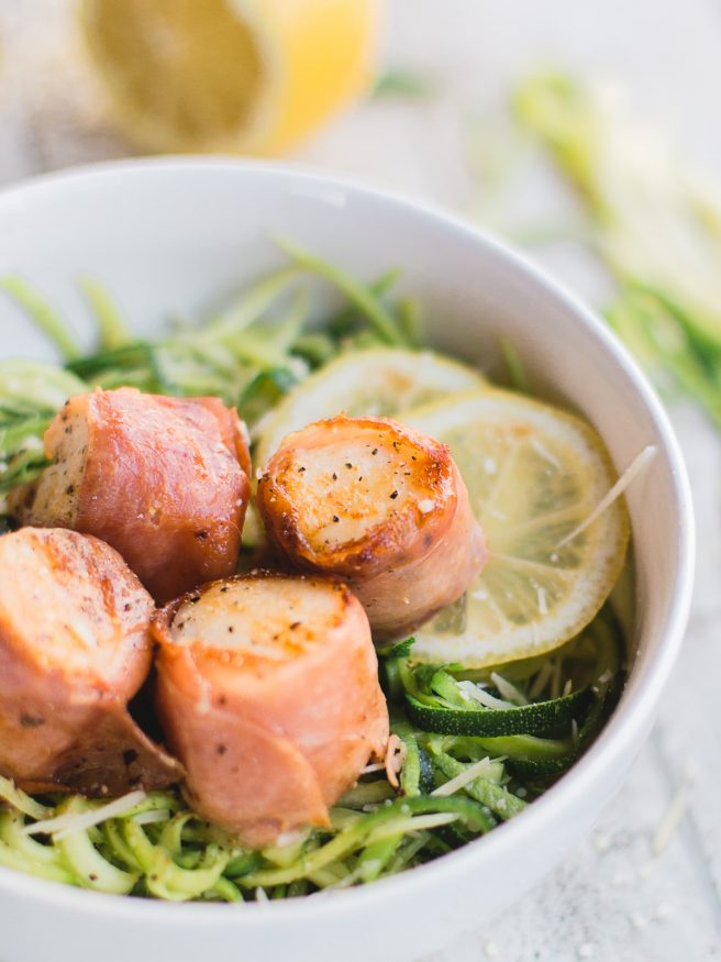Prosciutto Wrapped scallops served on Basil Parmesan Zoodles, this dish is light and fresh, and is full of flavor!