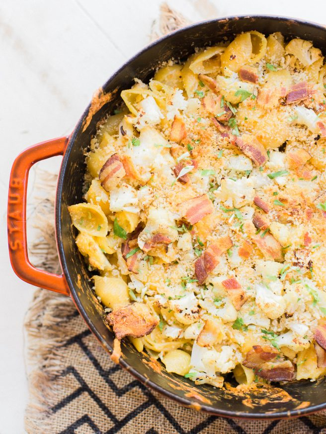 Homemade baked mac and cheese with roasted cauliflower and bacon mixed in. Loaded with cheddar and gruyere cheese, that's cheesy, smoky and full of flavor!