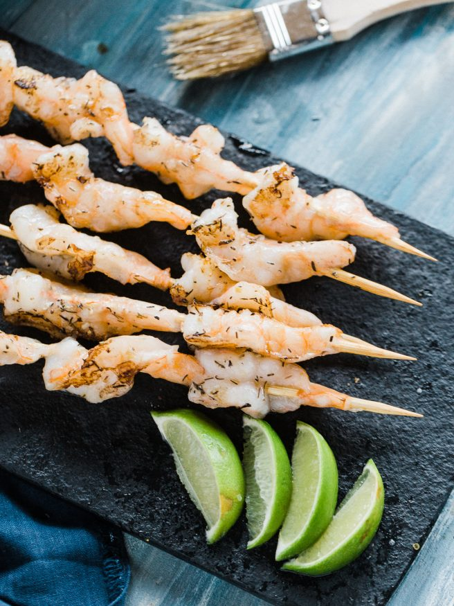 Grilled shrimp recipe with a garlic and herb butter. Insanely easy, delicious and perfect for summer grill outs!