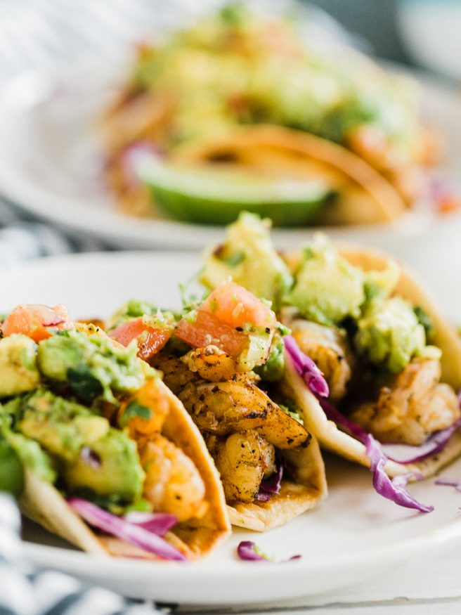 Spicy Shrimp Tacos cooked on the grill, with chili powder, red pepper flakes, cayenne pepper, and other spices. Perfect for the summer!