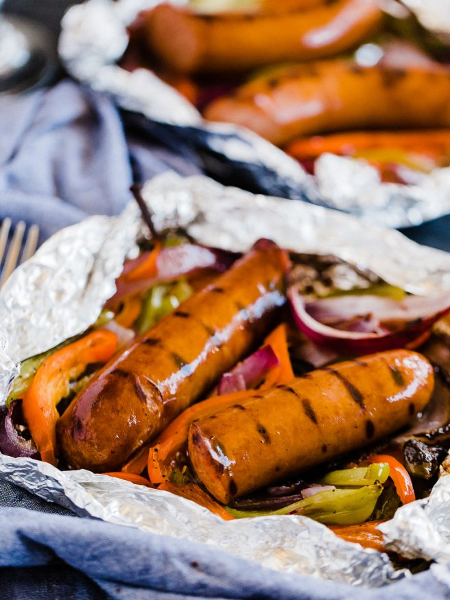 Sausage and Peppers done in foil packs making cooking, prep, and cleanup a breeze. Perfect for summer weeknights!