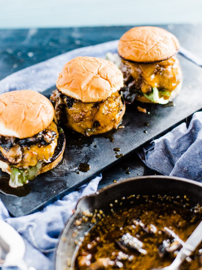 Teriyaki Burger topped with a Grilled pineapple, portabella mushroom, simmering in teriyaki sauce and topped on toasted Hawaiian hamburger rolls.