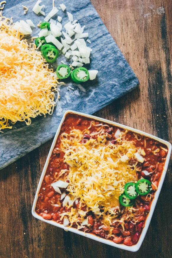 Slow cooked Chili with Ground beef tomatoes, beans and jalapenos and a spicy seasoning, This batch of chili is a great weeknight dinner!