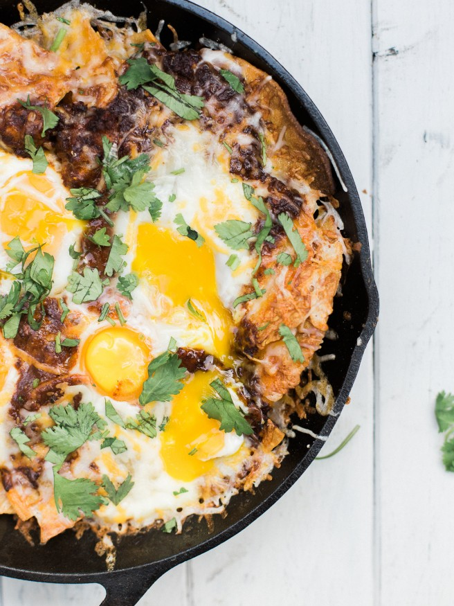 Chilaquiles Nachos with Chorizo and Egg - Chorizo mixed into a chile sauce for chilaquiles awesomeness topped with eggs! dadwithapan.com