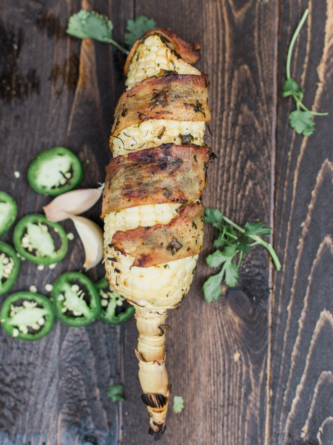 Bacon Wrapped Corn with a Jalapeno and Cilantro blend that will take your summer grilling to the next level! Full of flavor and spiciness! dadwithapan.com