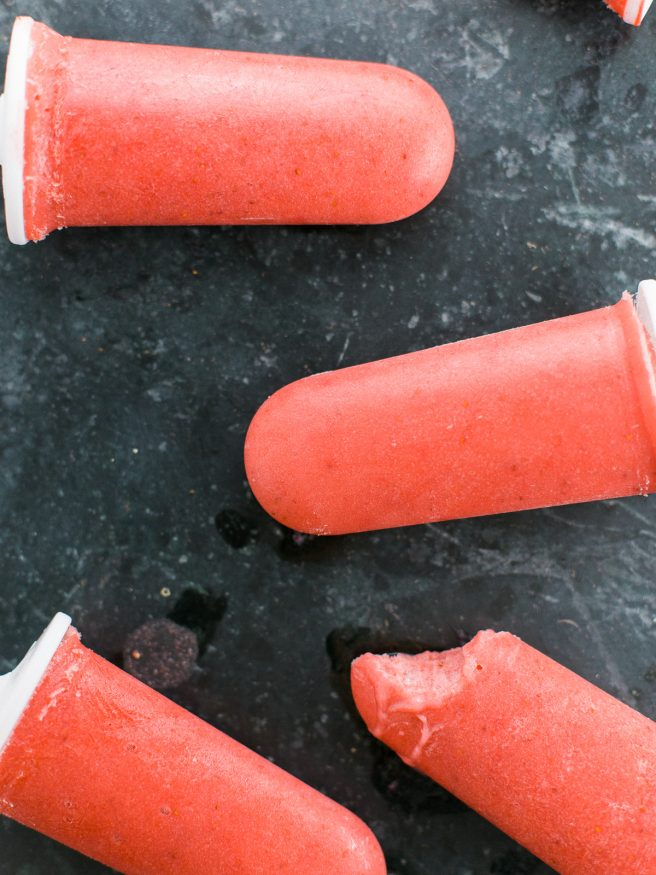 Popsicles with banana ice cream, strawberries, and coconut almond milk. Guiltless and perfect for a hot summer day!