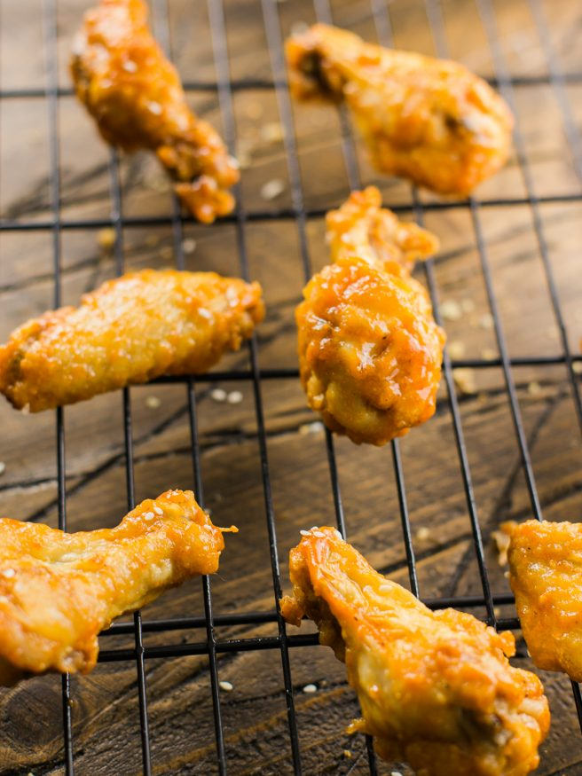 Honey Sriracha Beer Glaze - sounds amazing right? Put it over some crispy baked chicken wings and you have a match made in heaven!