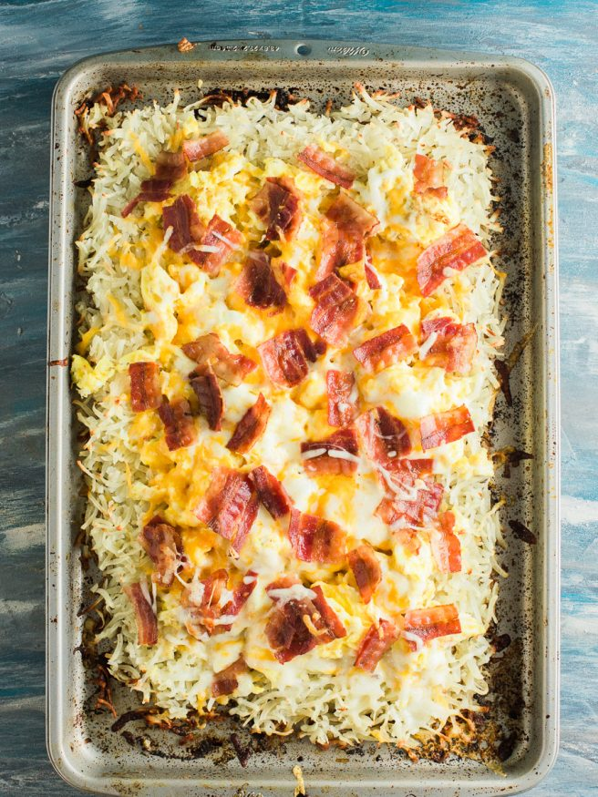 Hashbrown Breakfast pizza with a hash brown crust, topped with scrambled eggs, cheese and bacon. Such a great Saturday morning breakfast!