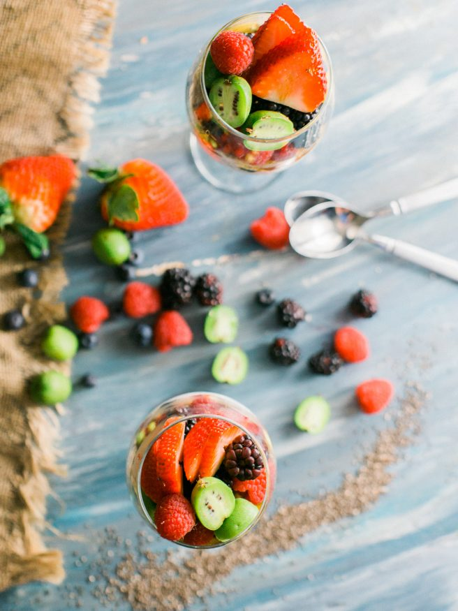 Chia parfait with a chia pudding and vanilla greek yogurt. Topped with honey, baby kiwis, and other fresh fruits. Makes a great quick and healthy breakfast!