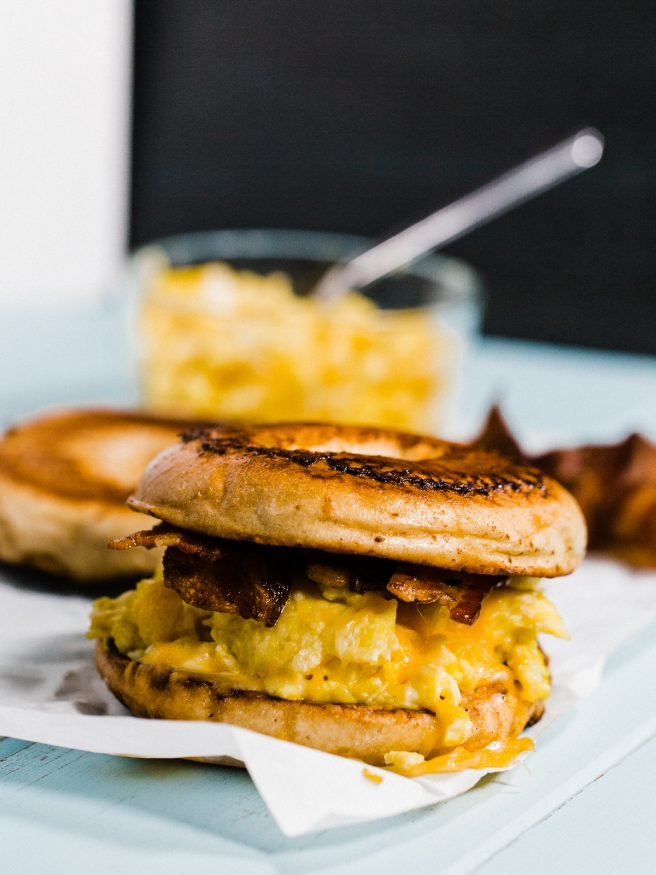 French Toast Bagel topped with eggs, cheese and smokey bacon, making for a sweet and savory breakfast sandwich everyone is going to love!
