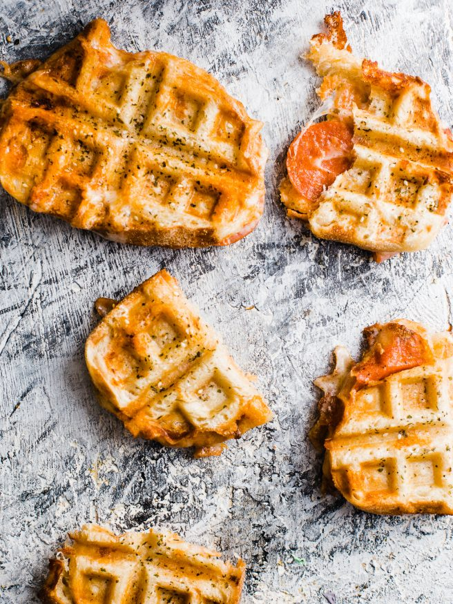 Pepperoni Pizza meets grilled cheese, meets waffle Iron making the best concoction known to man: Pepperoni Pizza Waffle Sandwich!