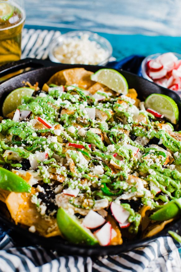 Beer marinated fish taco nachos with spicy avocado lime for Spicy fish taco sauce
