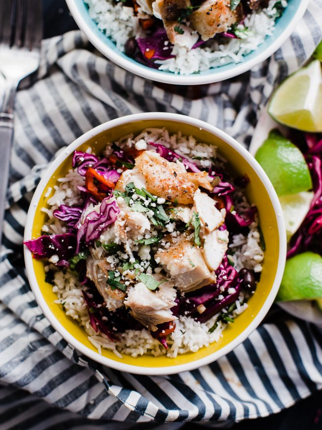 Fish Burrito Bowl with a spicy Cilantro Lime red cabbage slaw. Fresh and filling and makes a perfect weeknight meal!