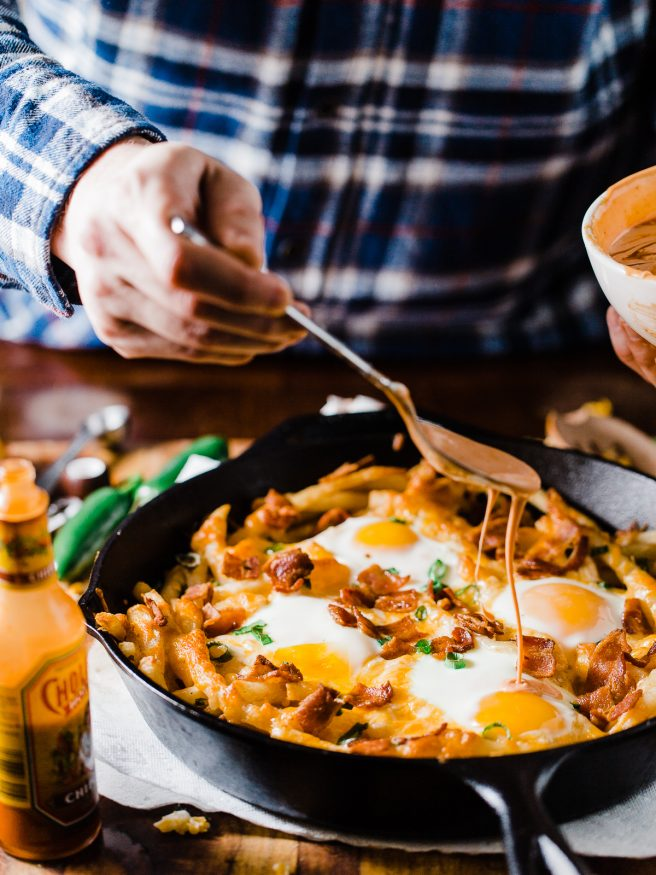 These loaded breakfast fries are topped with everything dreams are made of, bacon cheese, green onion, sunny side up eggs and a spicy aioli!