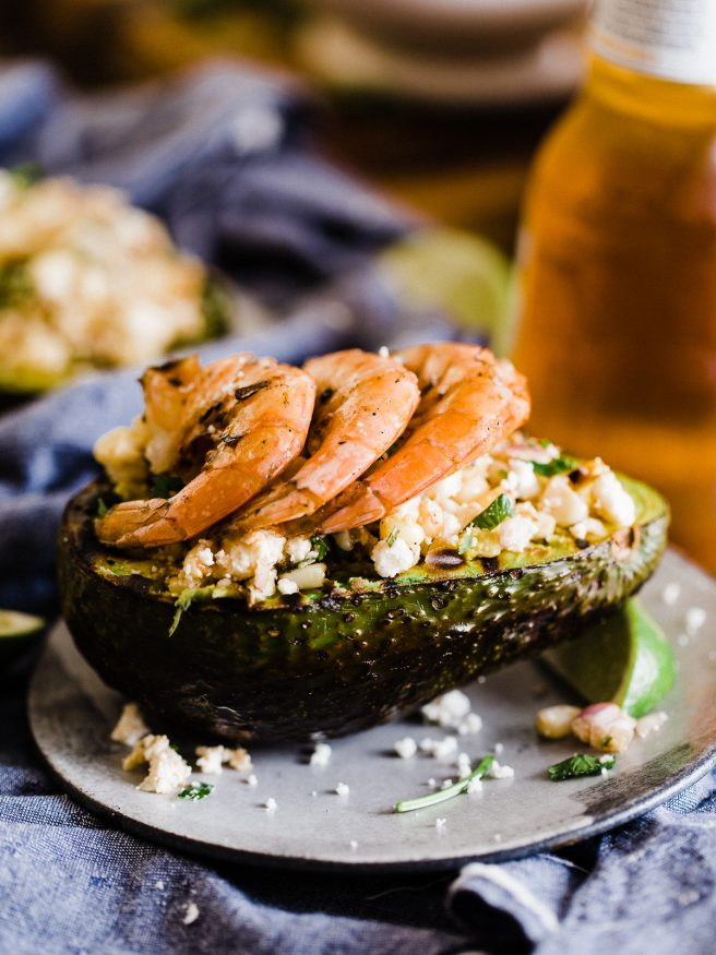 Grilled Avocado Bowl with Elote cut off the cob and topped with some grilled shrimp. This makes a great side dish or light lunch!