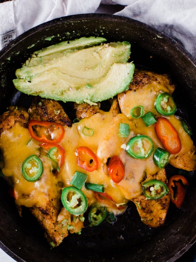 Spicy Skillet Chicken Tenders flambeed in tequila. Makes a great quick dinner, full of heat from fresno and serrano peppers and loaded with melted cheese on top!