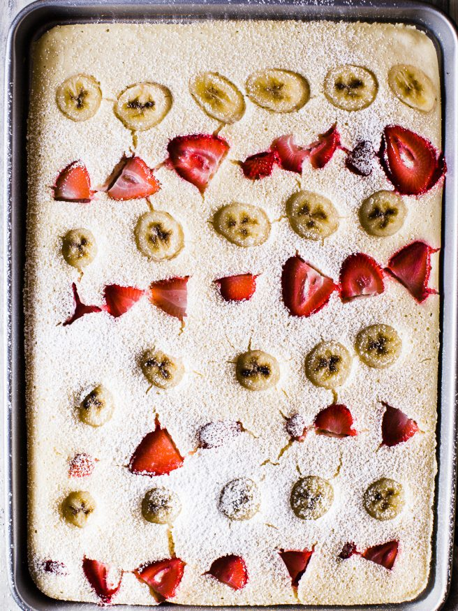 Sheet Pan Pancakes makes breakfast prep extremely easy. Adding fresh fruit on top of your pancakes in a sheet pan, to serve the whole family, or store in meal prep containers for the week!