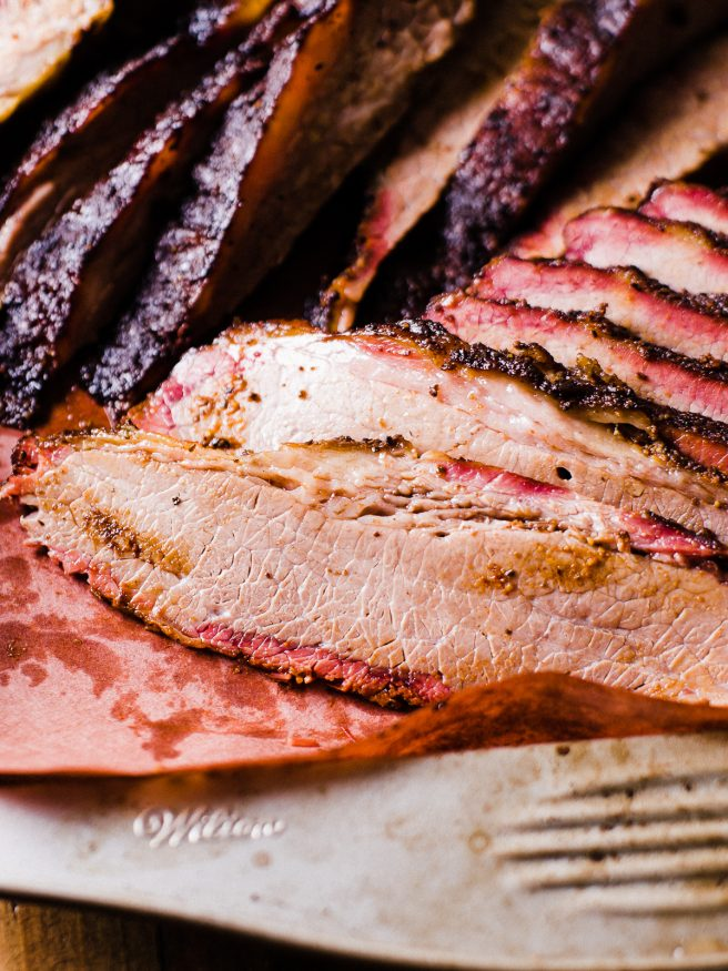 Low and Slow Smoked brisket with a simple pepper based Texas style rub. This is the perfect beginner recipe to get into brisket!