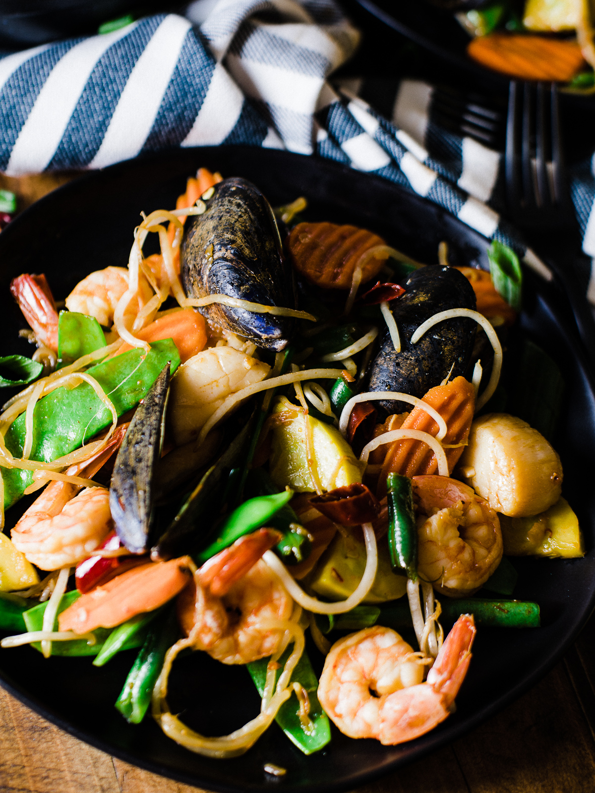 spicy seafood stir fry dad with a pan