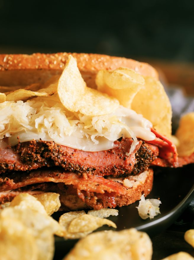 A Pastrami Reuben grilled on a panini press with crunchy kettle cooked chips. My absolute favorite way to do pastrami sandwiches!