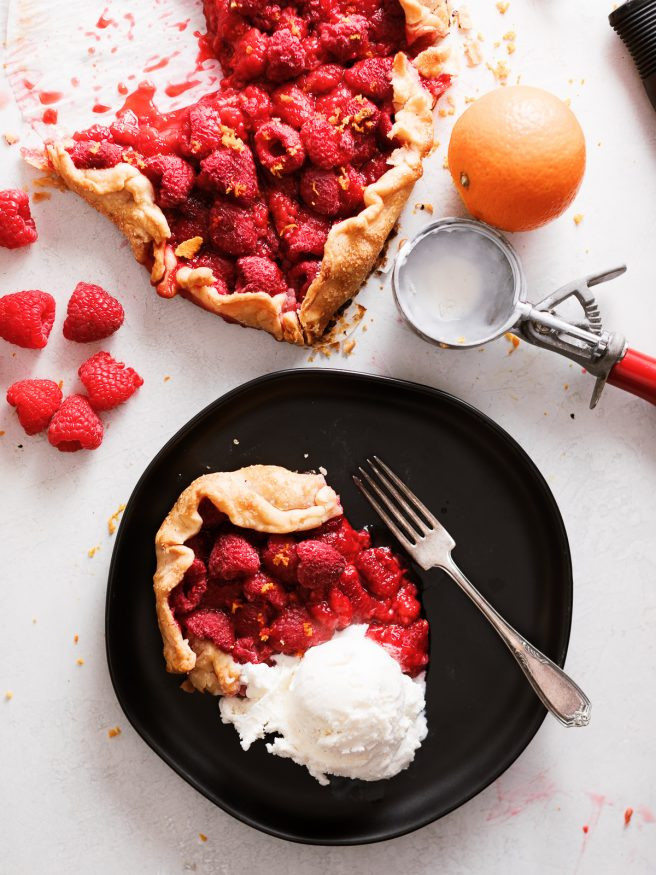 A raspberry galette in the shape of a heart. With raspberries, orange zest and a pre-made pie crust this makes the perfect Valentines Day dessert!