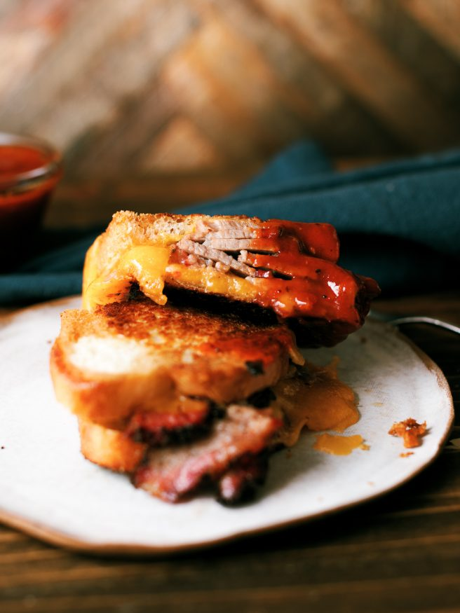 Smoky slices of brisket flat in between cheese and bread, to make a brisket grilled cheese sandwich that's a perfect use of leftover brisket!!