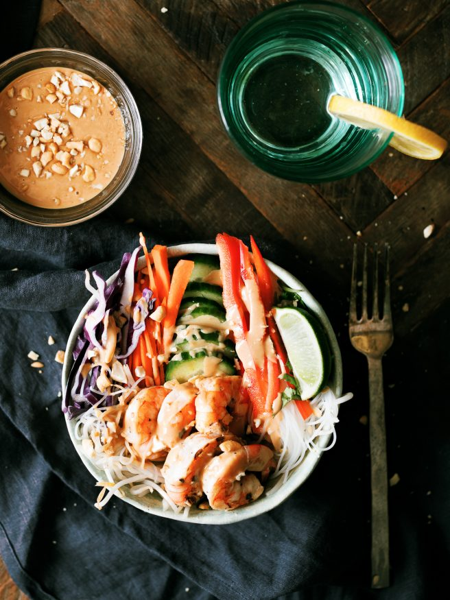 This spring roll bowl has grilled shrimp, rice stick noodles, and fresh veggies topped with a peanut sauce. Much easier to make than actual spring rolls!