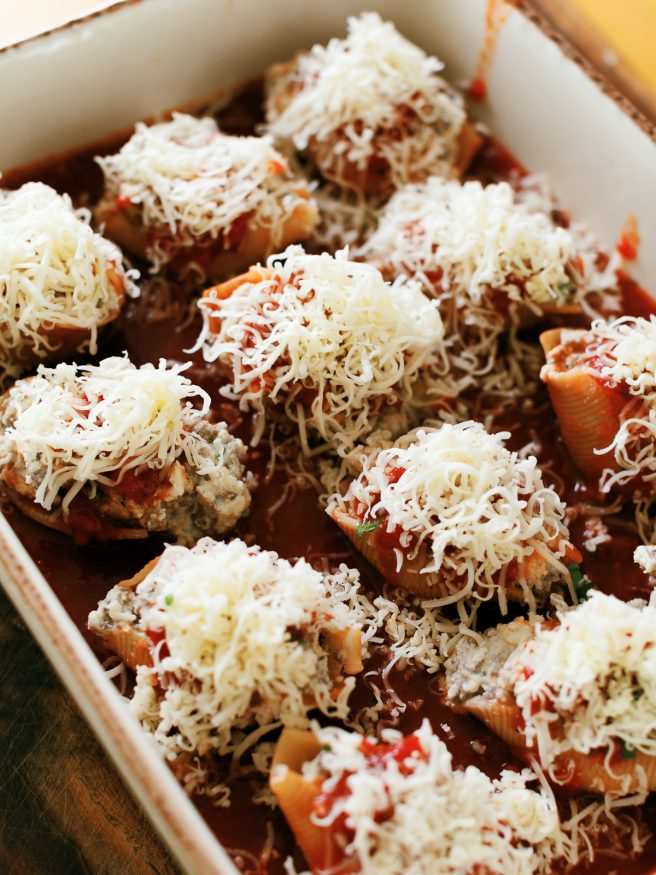 Lasagna stuffed shells with ground beef, ricotta and Italian seasonings, topped with mozzarella and can be made ahead of time!