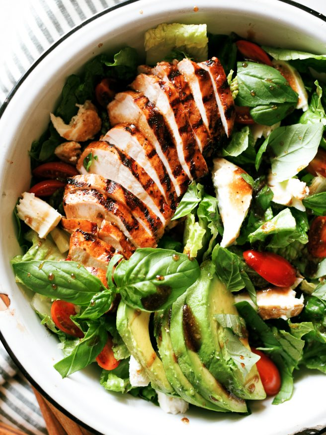 Grilled chicken caprese salad with balsamic marinaded chicken topped with fresh mozzarella, basil and cherry tomatoes. This is the perfect summer salad!