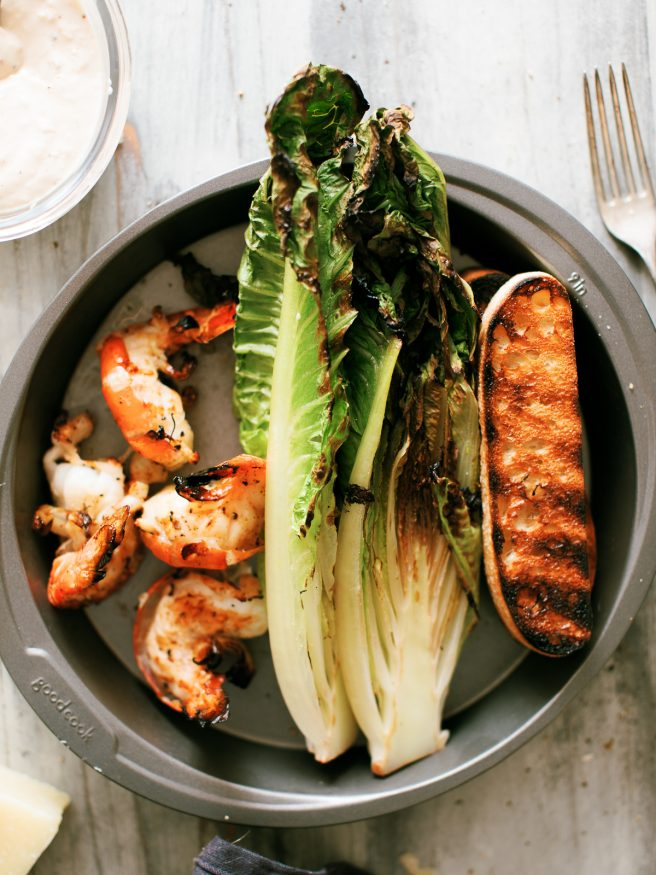 Grilled Caesar Salad, with grilled shrimp, grilled croutons, grilled romaine lettuce. The only thing that isn't grilled is the from scratch Caesar dressing!