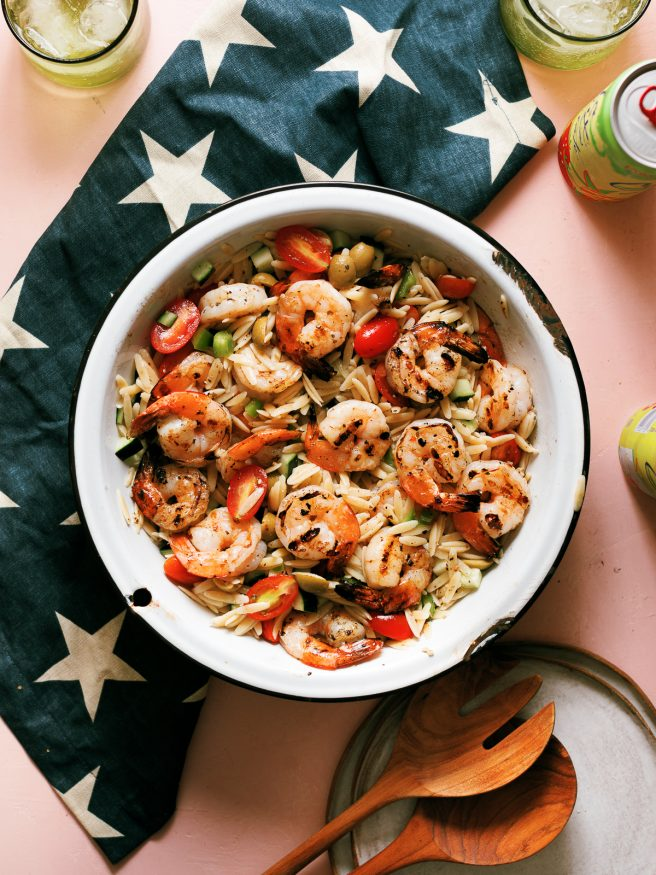 Zesty Grilled Shrimp, orzo pasta coated in an oil and vinegar based dressing with cucumber bell pepper cherry tomatoes. One of my favorite summer meals!
