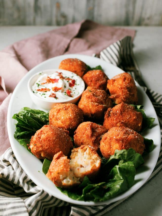 Fried Mashed Potato balls are loaded with cheese, bacon and a little garlic and herb seasoning. It's the perfect thanksgiving app!