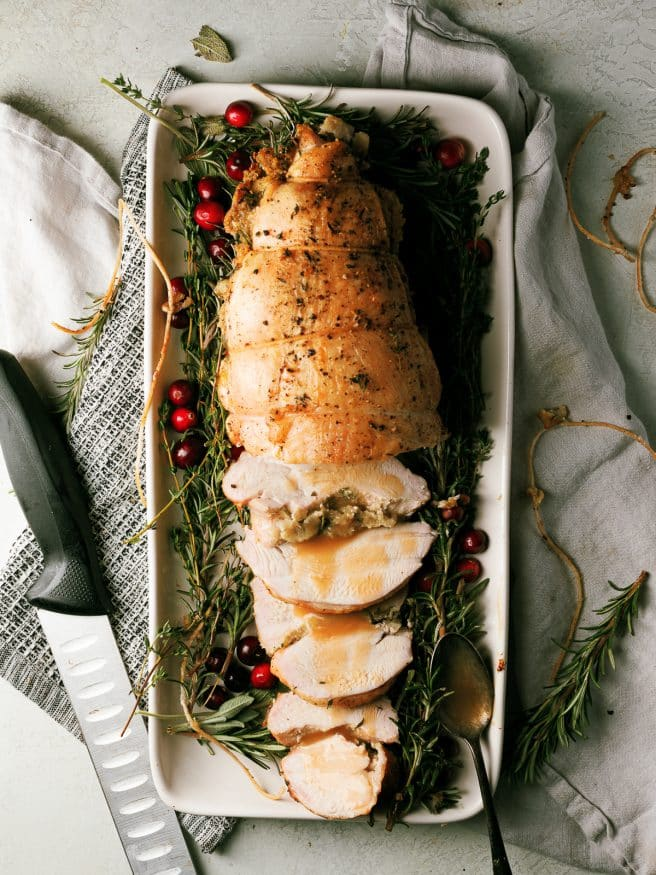 Roasted Turkey Breast tied in a roast, stuffed with an herbs and stuffing. Makes avoiding dark meat a thing of the past!