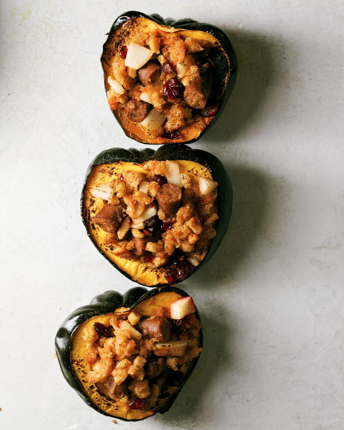 Roasted Acorn Squash with a sweet and savory breakfast  stuffing that is plant-based. Easily interchangeable with meat proteins to make this perfect everyone