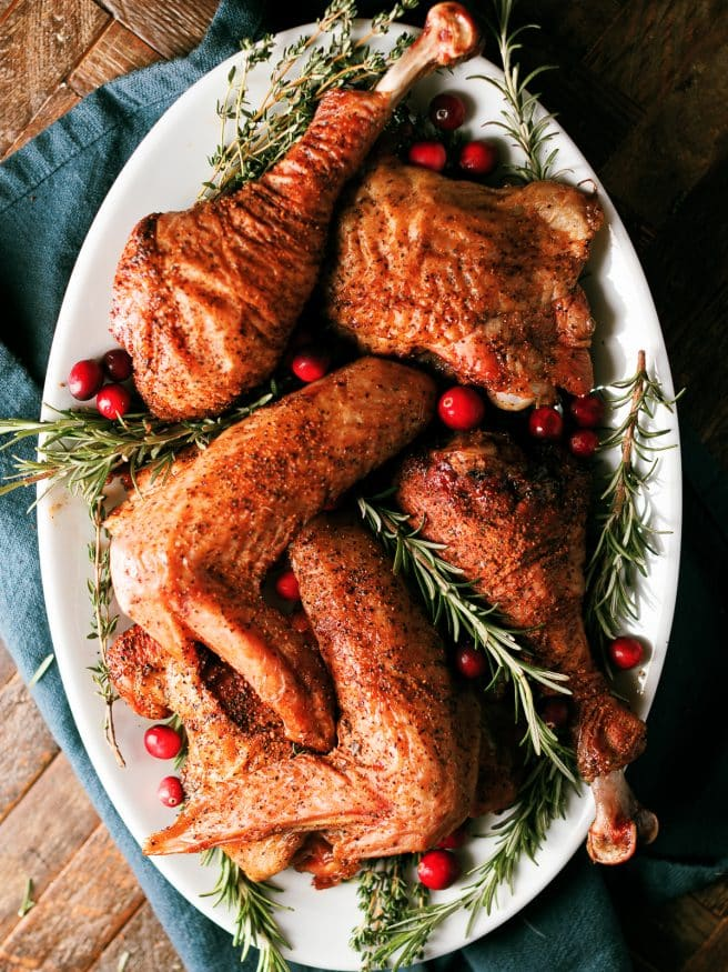 Smoked Turkey legs with a rosemary and sage brine that is perfect for all the dark meat lovers for Thanksgiving and Christmas dinner!