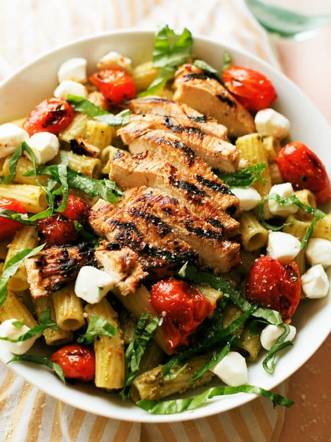 Grilled Chicken Caprese Pasta with a basil pesto and quick balsamic vinaigrette glazed chicken breast makes a quick dinner that can be done in 30 minutes.