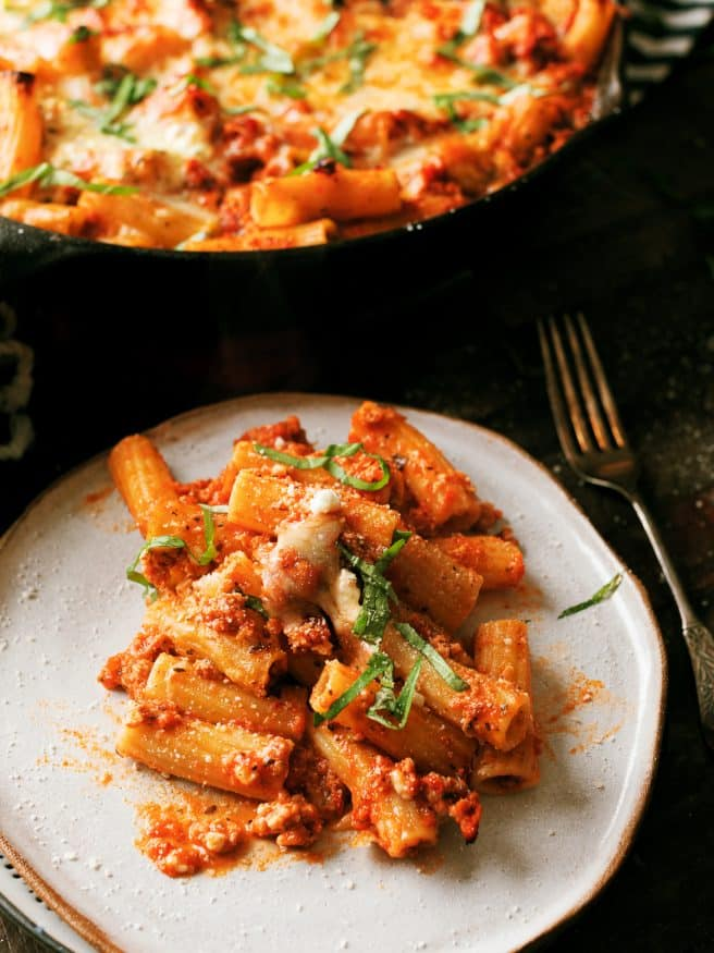 A Lasagna Pasta Skillet is a fun way to get your lasagna fix while changing things up a bit. It's like a lasagna meets baked ziti skillet, and its out of this world.