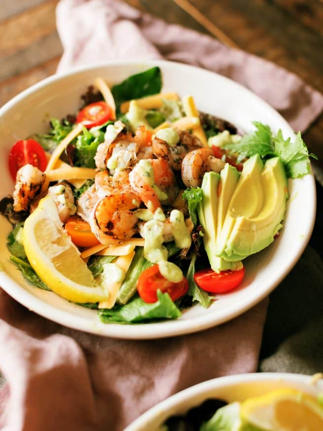 Grilled Shrimp Salad with Citrus Avocado Dressing seasoned with lemon garlic and a little cilantro. Perfect salad for the spring time!