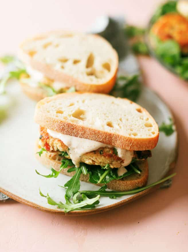 Tuna Fish Cake Sandwich packed with green onion, water chestnuts, jalapeno and topped off with an Old Bay Aioli that is amazing!