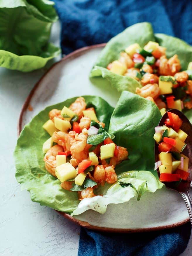 Margarita shrimp for lettuce wraps served up with a beautiful mango salsa. This is an amazing lunch or dinner!