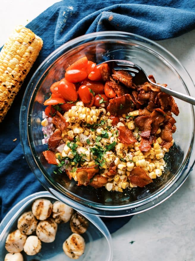 Bacon corn tomato salad with grilled scallops is a light and easy recipe to make for lunch or dinner. Its zesty, fresh, and full of flavor!
