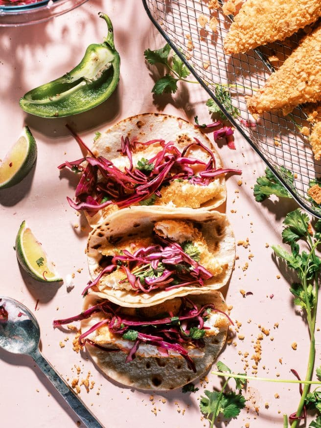 These tortilla chip crusted tilapia fish tacos with a jalapeno lime red cabbage slaw is exactly what you need in your life.