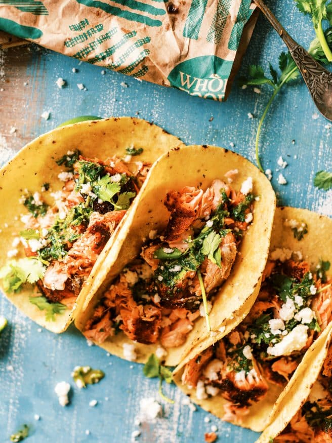Grilled blackened salmon tacos using Sockeye Salmon rubbed with a simple blackened seasoning. Topped with a spicy chimichurri will make amazing fish tacos!