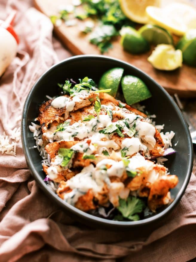 This grilled fish taco bowl is perfect for a weeknight. Beautiful fresh tilapia filets rubbed in a few simple spices, then topped with a cilantro aioli.
