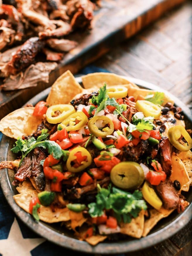 Texas Style Pulled Pork Nachos. Smoked Pulled Pork shoulder on top of cheesy nachos is the best way to spend your weekend.