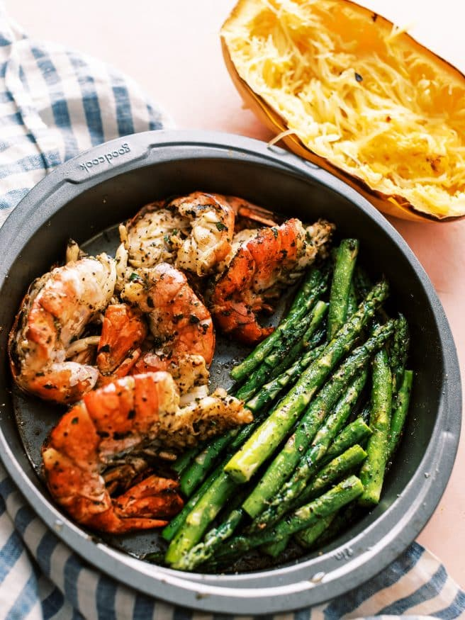 I'm going all out for this recipe and dressing up this spaghetti squash in pesto and topping with some grilled shrimp and asparagus!