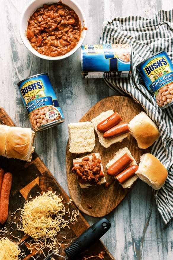 Easy weeknight chili dog sliders with from scratch 30 minute chili recipe. Perfect game day recipe or fun weeknight dinner!