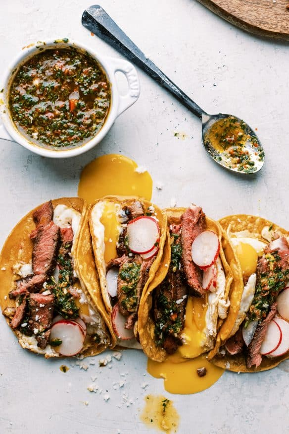 Steak and Egg Breakfast Tacos topped with some chimichurri and a little queso fresco and you've got a amazing twist on a breakfast classic!